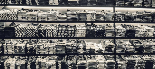Pile of t-shirts in a fashion store